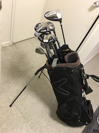 black and gray golf bag with golf clubs