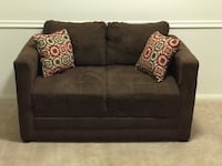 Brown fabric loveseat with throw pillows 171 mi