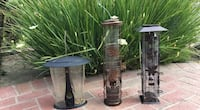 Squirrel proof birdseed feeders.  Recently purchased at Armstrong Garden Center for $39.95 each.  Landlord is not allowing tenant to use these bird feeders.  The set of three is $60.  Half a bag of bird seed is also included. Diamond Bar
