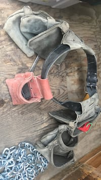 gray and red leather tool bag