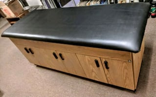 Massage table with cabinets