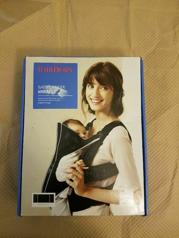 236b6be04dc Used Black and Silve BabyBjorn baby carrier miracle box for sale in Chicago