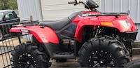 Red arctic cat atv
