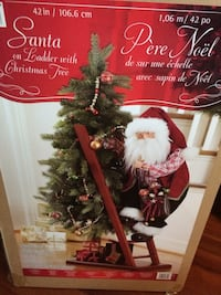 Santa on ladder with Christmas tree Laval, H7G