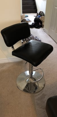 Black leather padded chair