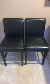 Two black barstool chairs