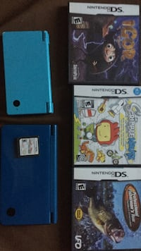 Two blue Nintendo DS and game cases
