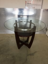 round glass top table with black wooden base Gaithersburg