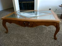 brown wooden framed glass top coffee table Plano, 75074
