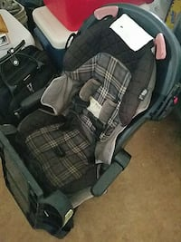 baby's black  and gray plaid stroller