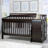 Baby Crib with changing table. Crib is convertible into a bed