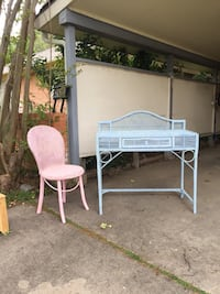 Wicker desk or vanity and pink wicker chair. Chair need a new seat, but cute little set!