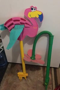 2 water sprinklers Crazy daisy. flapping flamingo  Kids love this....