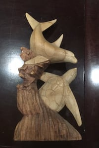 Hand carved wooded statue of dolphin and turtle Toronto, M1L 1W4