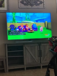 black flat screen TV with remote Moreno Valley