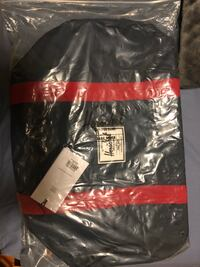 black and red Supreme crew-neck shirt pack 548 km