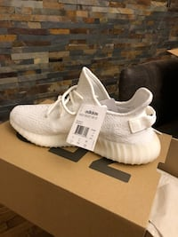 pair of white adidas NMD shoes with box