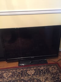 black flat screen TV with remote Gaithersburg, 20878