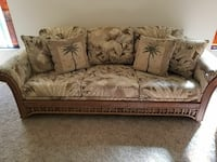 brown and white floral 3-seat sofa