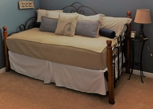 Daybed with trundle, mattress, cover, bedding, and lamp