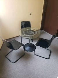 Small glass table +3 chairs