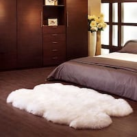 brown wooden bed frame with white bed comforter NEWYORK