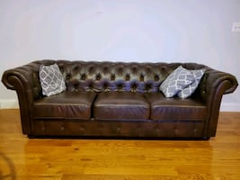 """90"""" Faux leather brown couch."""