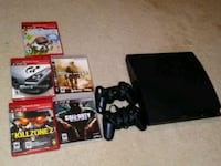 black Sony PS3 Slim with controllers and game cases Centreville, 20121