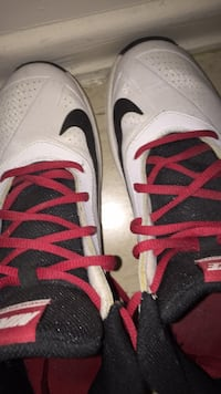 pair of white-and-red Nike basketball shoes Toronto, M6N