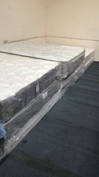 several white and grey bed mattresses