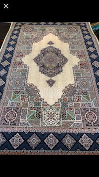 Green and brown area rug 548 km