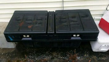 Truck tool box with tie down straps.