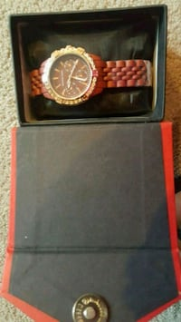 round gold-colored chronograph watch with black leather strap Surrey, V3X 1P3