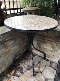 Round black metal framed patio table 25 mi