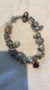 STERLING SILVER FULL PANDORA BRACLET. SOME CHARMS HAVE GOLD ON THEM. Vaughan, L6A 2V5