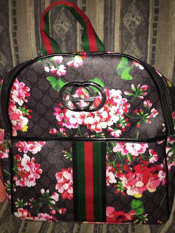 Used black pink and green floral gucci backpack for sale in Columbus ... 2c7567beeeb92