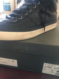 unpaired black Jimmy Choo sneaker