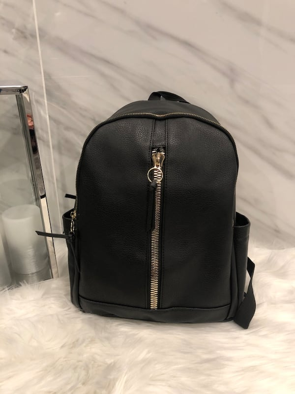 Madden girl black and gold leather backpack **OPEN TO OFFERS**. 6af656ea-725e-4fa7-a7e4-1656a58e75d4