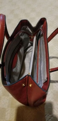 Red purse   brand new used a couple of days Mount Brydges, N0L 1W0
