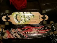 2 brown green and red black long boards Calgary