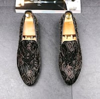 pair of black-and-brown leather flats Nevada