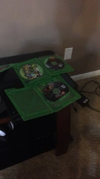 green Xbox One console with controller and game cases Houston, 77066