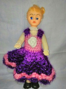 girl's pink and purple knitted dress doll