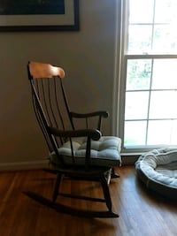 brown wooden rocking chair with brown cushion 33 km