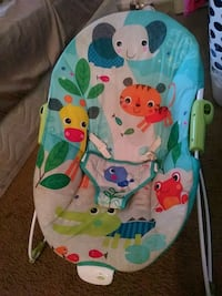 baby's teal and white bouncer