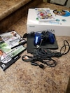 Sony PS2 Slim console, blue controller, and three games