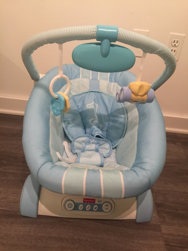 baby's blue and white bouncer