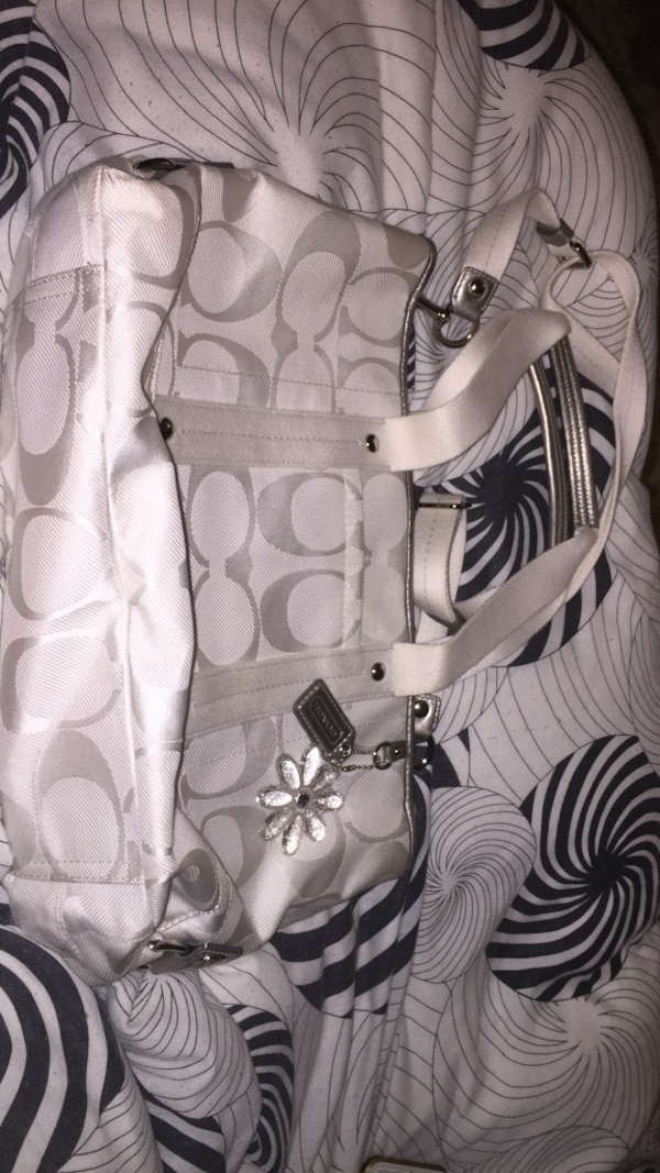 white and gray Coach leather shoulder bag