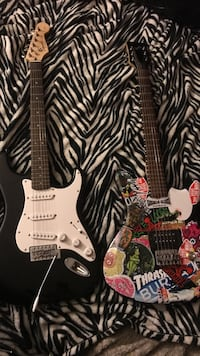 two multicolored and black-and-white electric guitars Crownsville, 21032