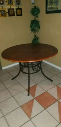 round brown wooden table with black metal base Waco, 76708